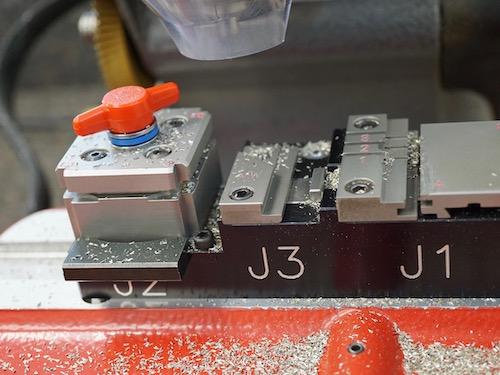 car key cutting machine with metal shavings everywhere