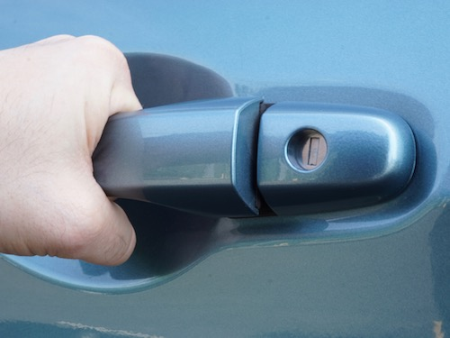 blue car door locked on Honda CRV and person pulling on handle because they are locked out