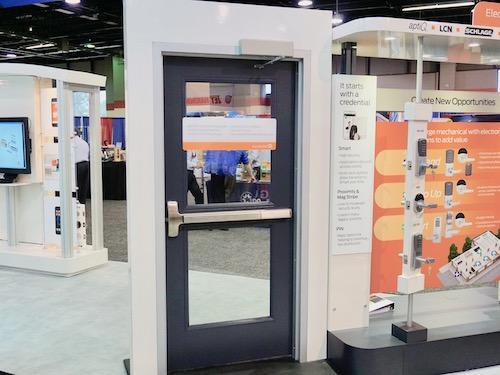 commercial metal door with door closer and panic bar.