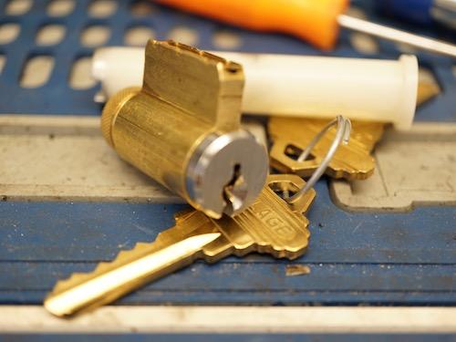 lock cylinder, plug follower, and keys.