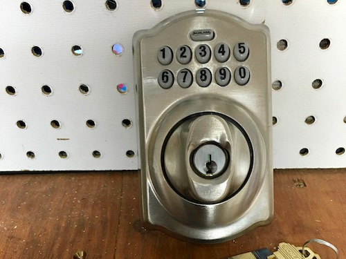Schlage smart lock about to get installed on a residential door in Phoenix, AZ