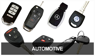 Image of a variety of car keys, fobs, and remotes